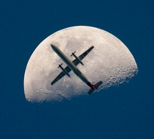 airplane passing the moon