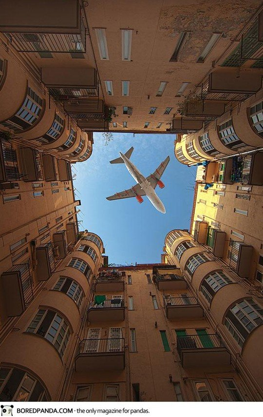 plane above the buildings
