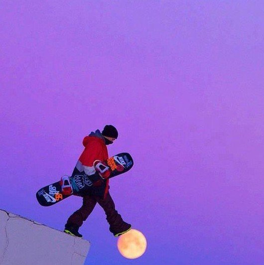 snowboarder walking on moon